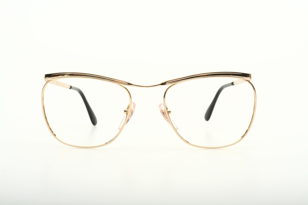 Elegant metal bar eyeglasses, golden colored, made in ...